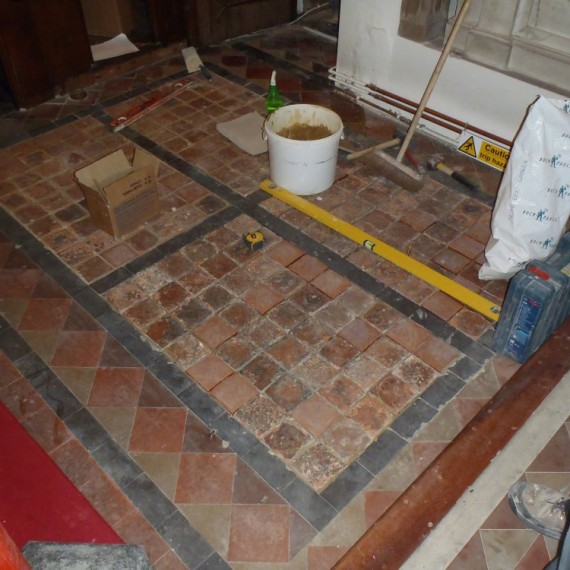 Sandridge church, tiles being re-laid, including replacements