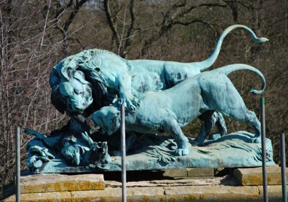 Harlaxton Front Circle, bronze lion and eroded stone base before conservation