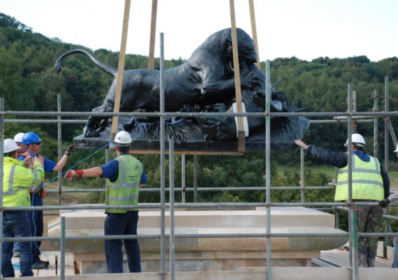 Harlaxton Front Circle, bronze lion being eased back into position