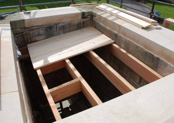 Harlaxton Front Circle, new roof structure being built, stone repairs complete, to gate lodge